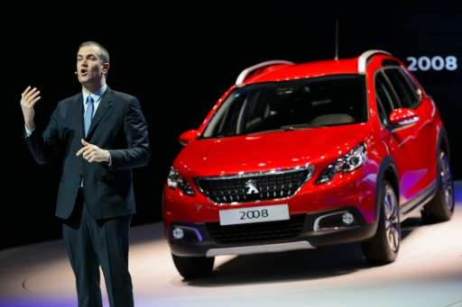 Peugeot Brand CEO Maxime Picat gestures while speaking in front of the new SUV Peugeot 2008, at the Geneva Motor Show on March 1
