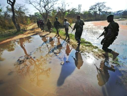 Rangers set out on the hunt for elephant poachers in the Garamba National Park in north-eastern Democratic Republic of Congo on