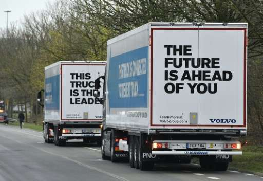 Semi-automated trucks are driven on the E19 highway in Vilvoorde on April 5, 2016 as part of the 'EU Truck Platooning Challenge'