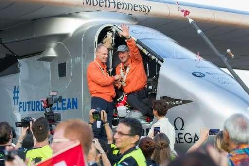 Solar Impulse 2 pilots Bertrand Piccard (L) and Andre Borschberg wave after landing at Kalaeloa Airport, Hawaii on July 3, 2015