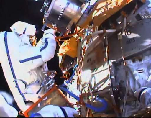 Spacewalkers collect experiments, toss flash drive overboard