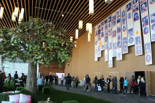 TED attendees pass a nature-themed socializing spot outside the conference theater, at the Vancouver convention cente, on Februa