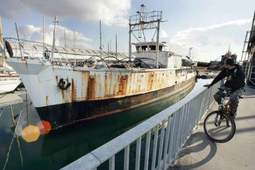 The famous ship of late French oceanographer Jacques Cousteau, the Calypso, is docked at the port of La Rochelle on November 17,