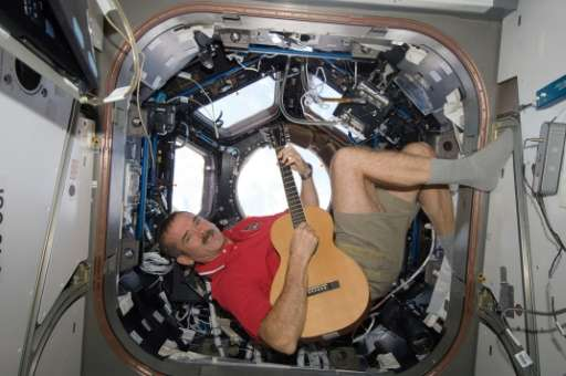 This December 25, 2012 NASA photo shows Canadian Space Agency astronaut Chris Hadfield playing his guitar in the International S