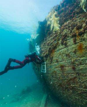 Underwater archaeologists explore the wreck of the Erebus
