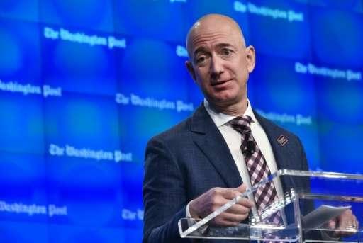 Washington Post owner Jeff Bezos speaks during the inauguration of the Washington Post Headquarters on January 28, 2016 in Washi