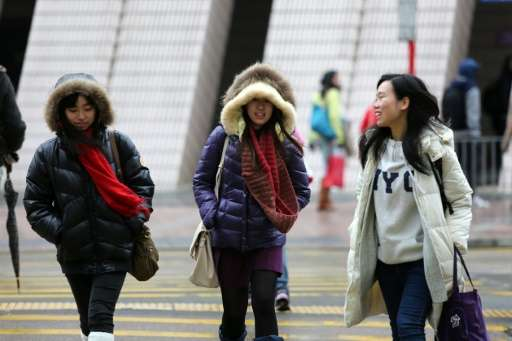 "Weather officials in Hong Kong have issued a frost warning saying an ""intense cold surge"" is in place, coupled with ch"