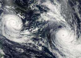 A NASA satellite mosaic of twin tropical troublesome cyclones: Tomas and Ului