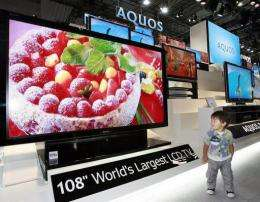 A boy looks at a prototype model of the world's largest 108-inch sized LCD TV