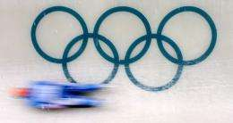 A competitor speeds down the course during the group A men's singles Luge practice session