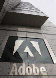 Adobe posts lower 1Q profit, exceeds expectations (AP)