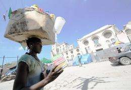 A Haitian vendor sells goods on October 14, near the destroyed Port-au-Prince Cathedral