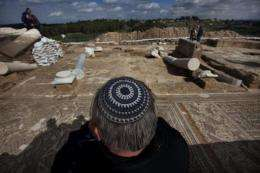 A man looks at a Byzantine period church after it was discovered following excavations in Horbat Midras
