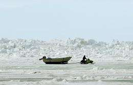 A man pulls a whaler's boat across the frozen Arctic Ocean in Browerville, Alaska, in 2006