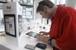 A man tests the Apple iPad at an electronics store in Brussels