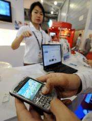 A man tries out a Blackberry mobile phone in Singapore