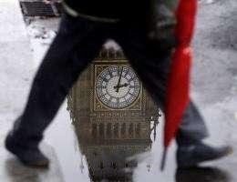 A man walks across Parliament Square