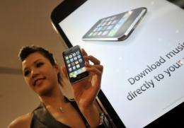 A model holds a 3G iPhone during its launch in Hong Kong