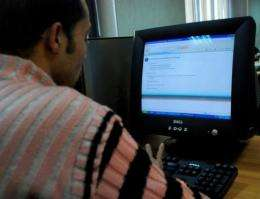 An Egyptian man tries to access a website at an Internet cafe in Cairo