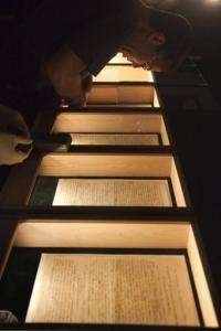 An employee prepares an exhibition showcasing the original manuscript of Albert Einstein's General Theory of Relativity