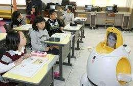 An English-teaching robot (R),