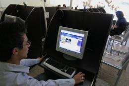An Iranian youth browses at an internet cafe in the city of Hamadan in 2009