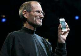 Apple chief executive Steve Jobs holds the iPhone 4