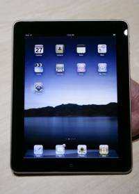 Apple Inc.'s new iPad, which doubles as a full-color e-reader of books, newspapers and magazines