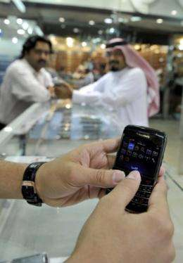 A Saudi Arabian man checks his BlackBerry at a store in the Red Sea coastal city of Jeddah