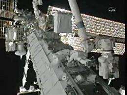 Astronauts (C) from the International Space Station out on a spacewalk on August 16