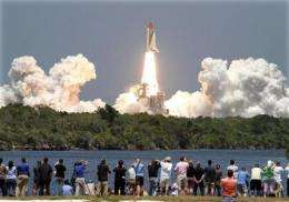 Astronauts forced into shorter shuttle survey (AP)
