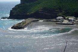 A wave hits the coast of the Hakahau city in the French Polynesia Marquesas Ua Pou island