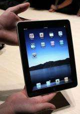 A worker holds the new Apple iPad