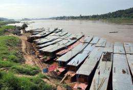 Boats lined up along the Mekong River in Laos
