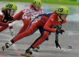 Britain's Sarah Lindsay is seen leading the pack during a women's 500m short-track qualifying heat