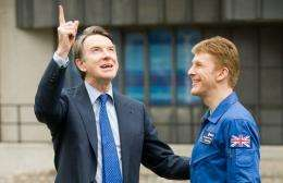 Business Secretary Peter Mandelson (L) speaks with astronaut Major Timothy Peake