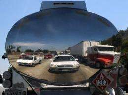 cars are reflected in a gas truck in a traffic jam in Los Angeles, California