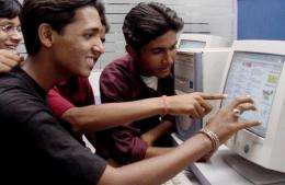 File photo of Indian school children checking the results of the Jharkhand state secondary school examination