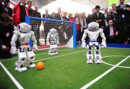 Four pint-sized robot footballers attracted huge cheering crowds