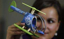 Germany sells vision for 'green toys' to world (AP)