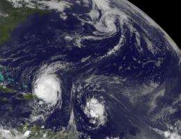 GOES-13 catches 3 tropical cyclones thrashing through the Atlantic