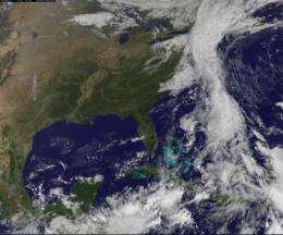 GOES-13 sees an unholy matrimony: Nicole and low pressure swamp the US East Coast