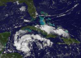 GOES-13 sees system 92L looking more like a tropical depression