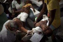 Haiti's cholera death toll grows, fueling riots (AP)