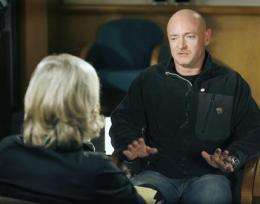 Husband: Giffords smiled and gave him neck rub (AP)