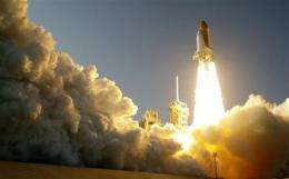 Injured astronaut aboard space shuttle 'in spirit' (AP)