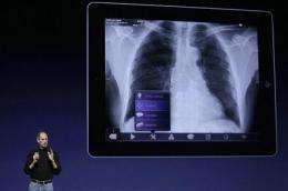 Jobs, on medical leave, appears at iPad event (AP)