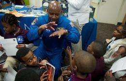 Leland Melvin speaking to elementary school students