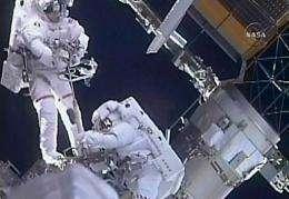NASA astronauts Steve Bowen (L) and Mike Good during a spacewalk
