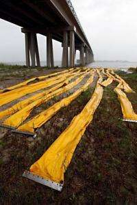 Oil containment booms are seen staged at the edge of Lake Pontchartrain near the Rigolets in New Orleans